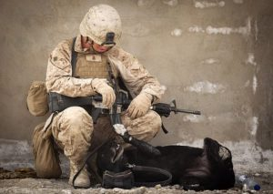 military man and dog